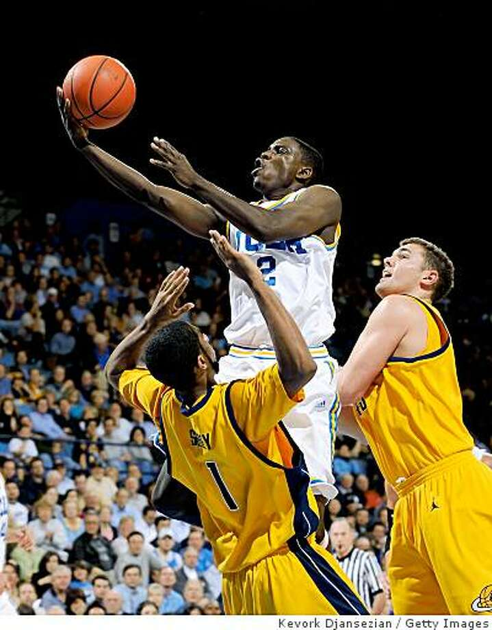 WESTWOOD, CA - JANUARY 29:   Darren Collison #2 of the UCLA Bruins scores on a layup against D.J. Seeley #1 and Harper Kamp #43 of the University of California Golden Bears during the second half of the game at Pauley Pavilion January 29, 2009 in Westwood, California. Collison finished with 18 points and UCLA won, 81-66.  (Photo by Kevork Djansezian/Getty Images) Photo: Kevork Djansezian, Getty Images