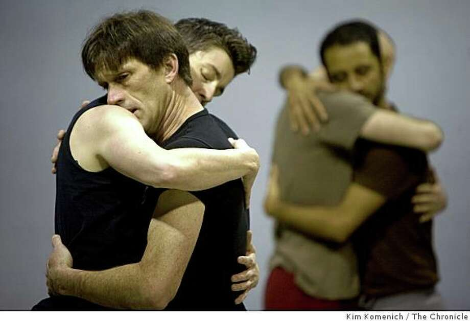 "Dancer Brian Fisher (front) embraces choreographer Sean Dorsey as the dancers from ""Uncovered: The Diary Project"" rehearse at Dance Mission in San Francisco, Calif., on Friday, Jan. 23, 2009. Photo: Kim Komenich, The Chronicle"