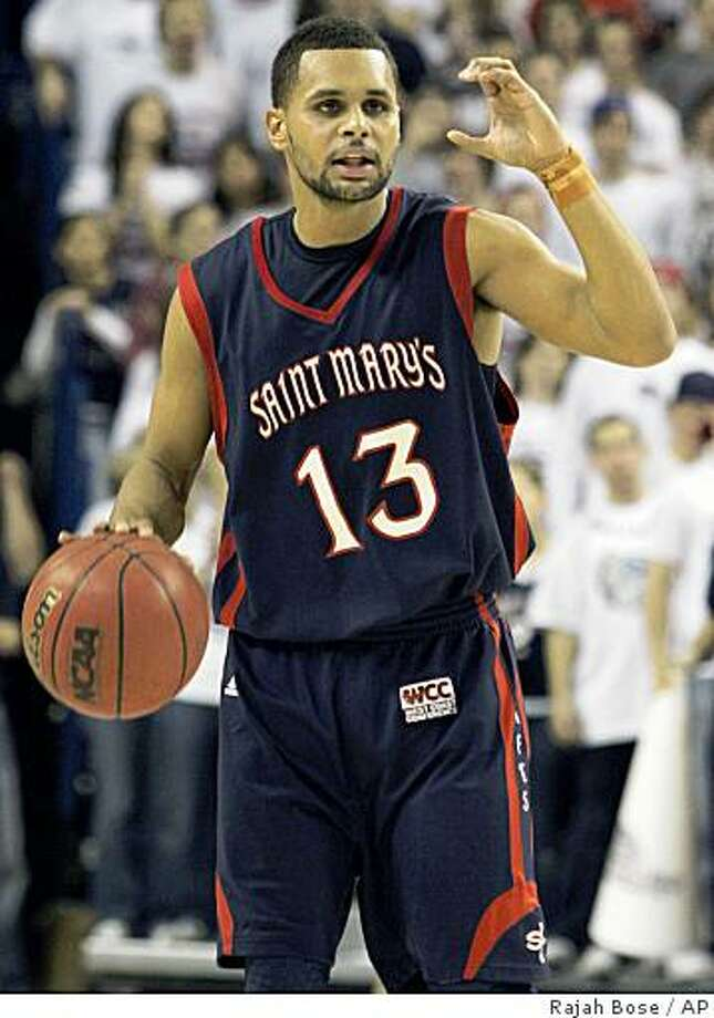 Saint Mary's Patrick Mills gestures in the first half of an NCAA college basketball game against Gonzaga in Spokane, Wash. on Thursday, Jan. 29, 2009. Mills scored 18 points but suffered a wrist injury late in the first half, he did not return to the game. Photo: Rajah Bose, AP