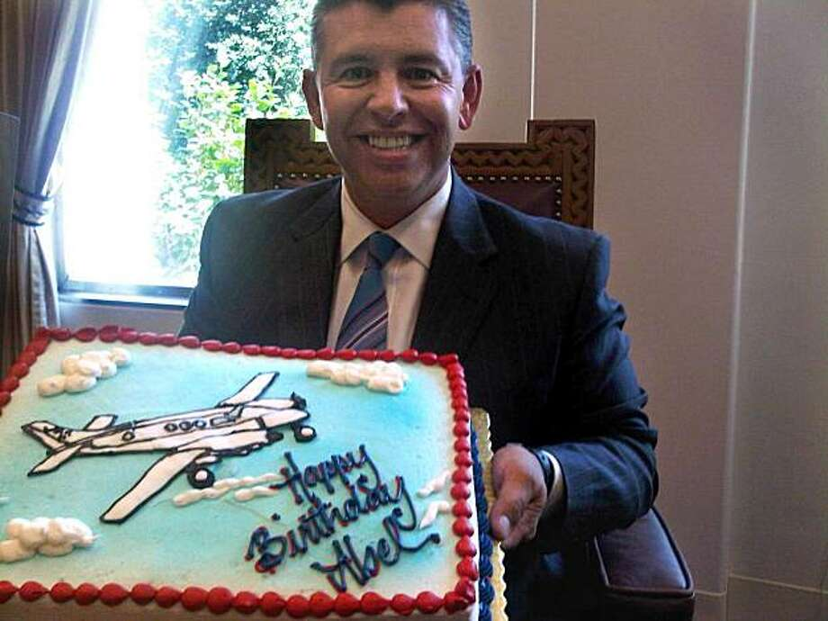 Lt. Gov. Able Maldonado poses with birthday cake showing his favorite hobby - flying. Photo: Courtesy Office Of Lt. Governor