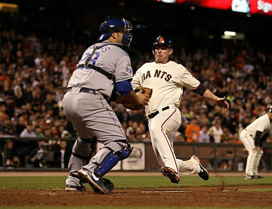 SAN FRANCISCO - SEPTEMBER 15:  Aubrey Huff #17 of the San Francisco Giants safely scores on Rod Barajas #28 of the Los Angeles Dodgers to give the Giants a 2-0 lead in the eighth inning at AT&T Park on September 15, 2010 in San Francisco, California. Photo: Ezra Shaw, Getty Images