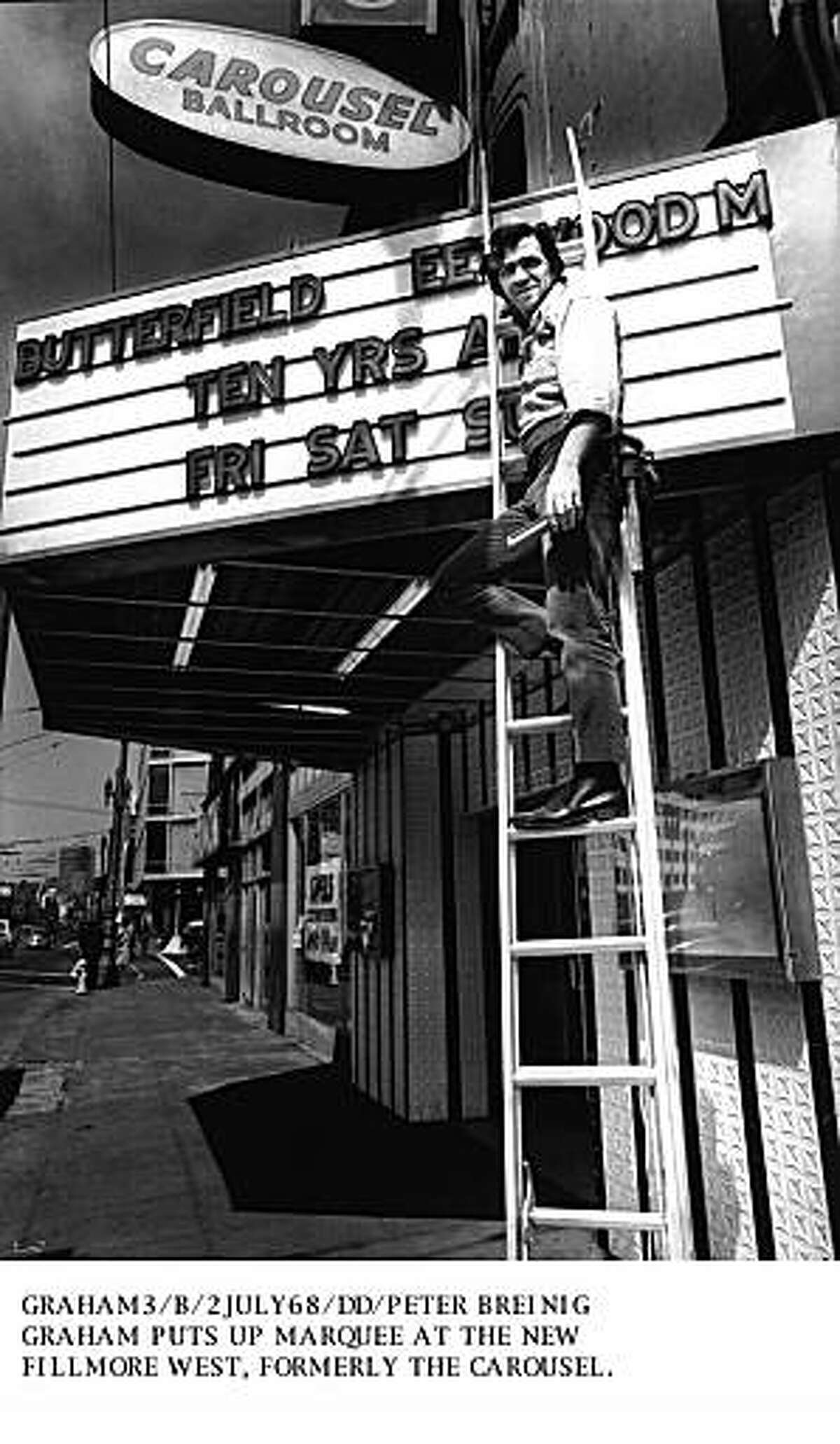 BILL GRAHAM, WITH THE MARQUEE OF HIS FILLMORE WEST NIGHTCLUB, FORMERLY THE CAROUSEL BALLROOM