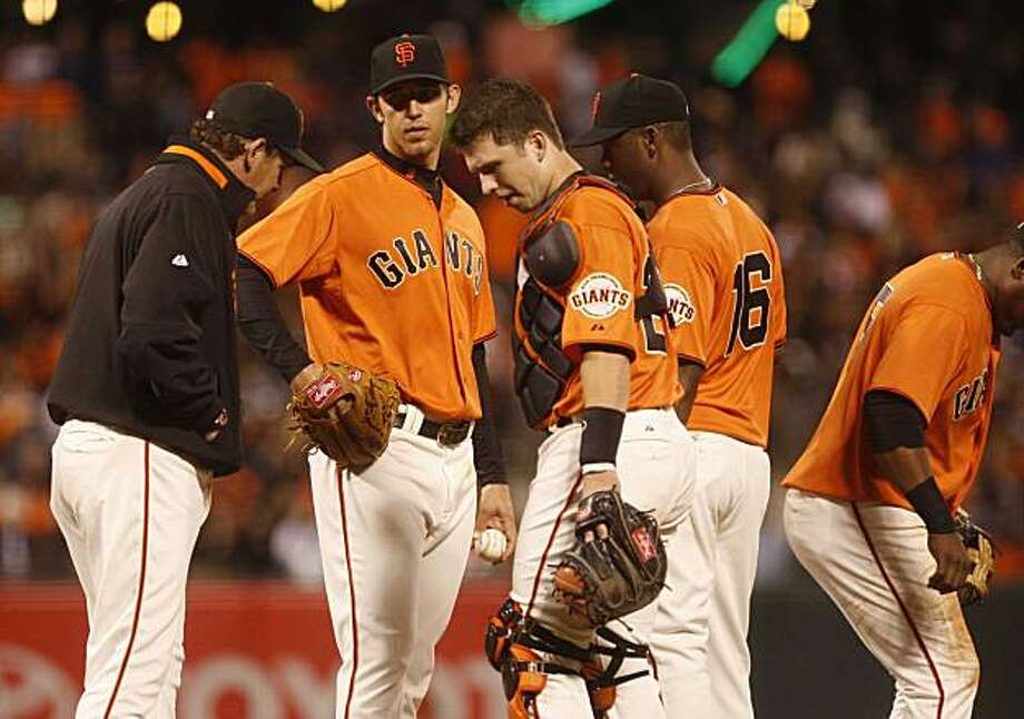 Signs of trouble in the 5th inning, Giants pitcher Madison Bumgarner meets with the coach and his teammates on the mound during the San Francisco Giants game against the Milwaukee Brewers on Friday Sept. 19, 2010 in San Francisco Calif. Photo: Mike Kepka, The Chronicle