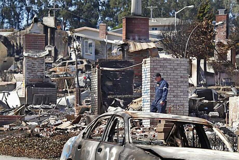 CHP inspector Mark Andrews walks through the blast site Monday, identifying cars that were destroyed in the explosion in San Bruno. Photo: Lacy Atkins, The Chronicle