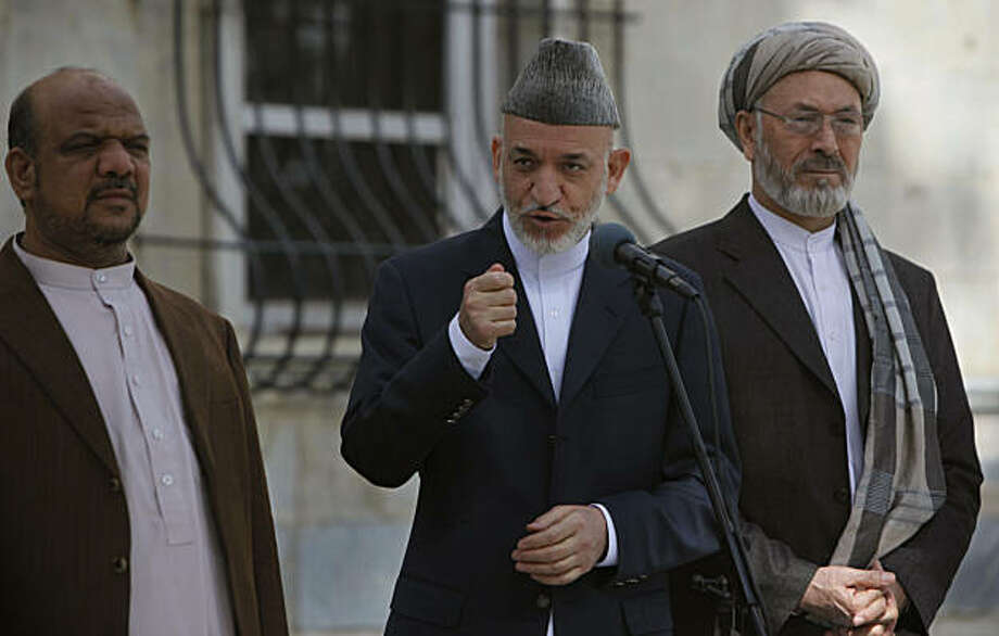 Afghan President Hamid Karzai, center, flanked by First Vice President Muhammad Qasim Fahim, left, and Second Vice President Mohammad Karim Khalili, delivers a speech in Kabul, Afghanistan, Friday, Sept. 17, 2010. Karzai urged Afghans to vote in this weekend's parliamentary election despite threats from the Taliban warning people not to leave their homes. Photo: Gemunu Amarasinghe, AP