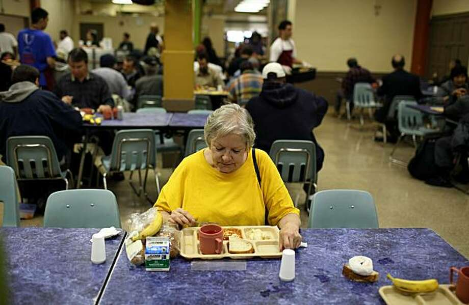 A woman named Pam eats a free meal at the St. Anthony foundation dining room on September 16, 2010 in San Francisco, California. The U.S. poverty rate increased to a 14.3 percent in 2009, the highest level since 1994. St. Anthony Foundation serves an average of 2,600 meals a day to homeless and impoverished people in San Francisco. Photo: Justin Sullivan, Getty Images