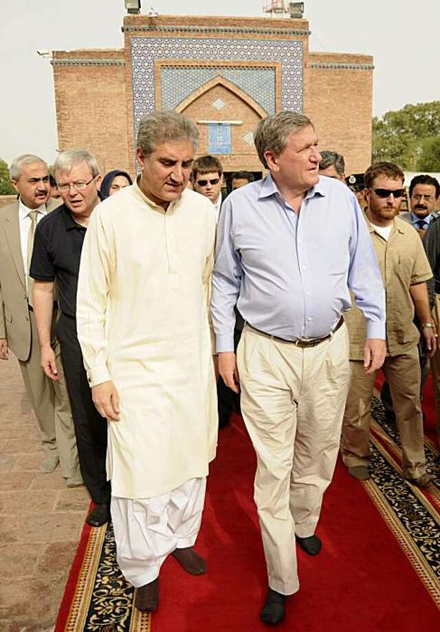 U.S. Special Envoy to Pakistan Richard Holbrooke, right, visits the shrine of a Sufi saint with Pakistan's Foreign Minister Shah Mahmood Qureshi in Multan, Pakistan Thursday, Sept. 16, 2010. The world will only be able to fund around 25 percent of the tens of billions of dollars needed to rebuild Pakistan after the floods, and its government will have to make up the shortfall, the U.S. envoy to the country warned Thursday. Photo: Khalid Tanveer, AP
