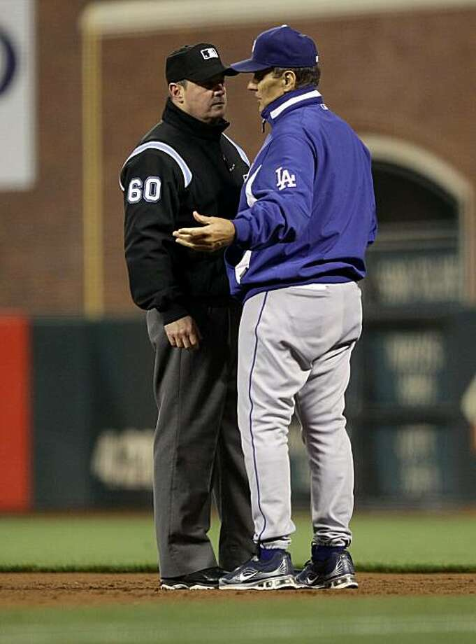 SAN FRANCISCO - SEPTEMBER 15:  Manager Joe Torre argues with umpire Marty Foster after Matt Cain #18 of the San Francisco Giants threw out Ryan Theriot #13 of the Los Angeles Dodgers when Theriot tried to bunt in the sixth ining at AT&T Park on September15, 2010 in San Francisco, California. Photo: Ezra Shaw, Getty Images