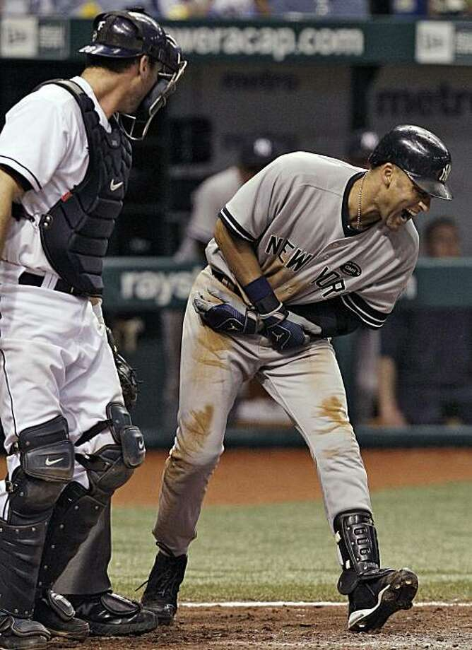 New York Yankees' Derek Jeter, right, screams after being hit with a seventh-inning pitch by Tampa Bay Rays reliever Chad Qualls during a baseball game Wednesday, Sept. 15, 2010, in St. Petersburg, Fla. Looking on is Rays catcher John Jaso. Photo: Chris O'Meara, AP