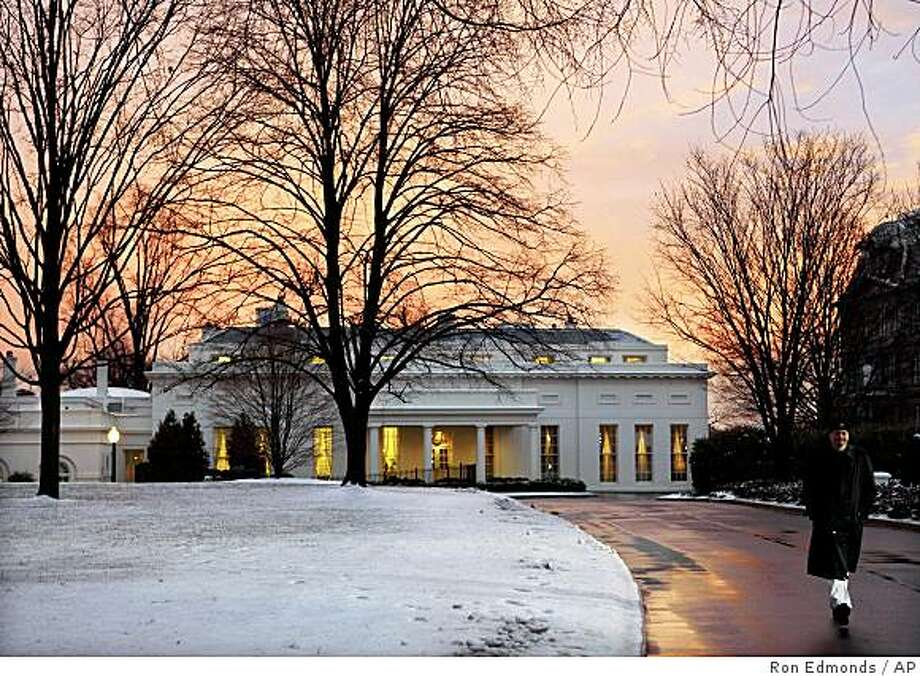 The West Wing of the White House is warmed by the setting sun, Wednesday,  Jan. 28, 2009,  as President Barack Obama waits to hear the final vote on his stimulus plan on Capitol Hill in Washington.  (AP Photo/Ron Edmonds) Photo: Ron Edmonds, AP
