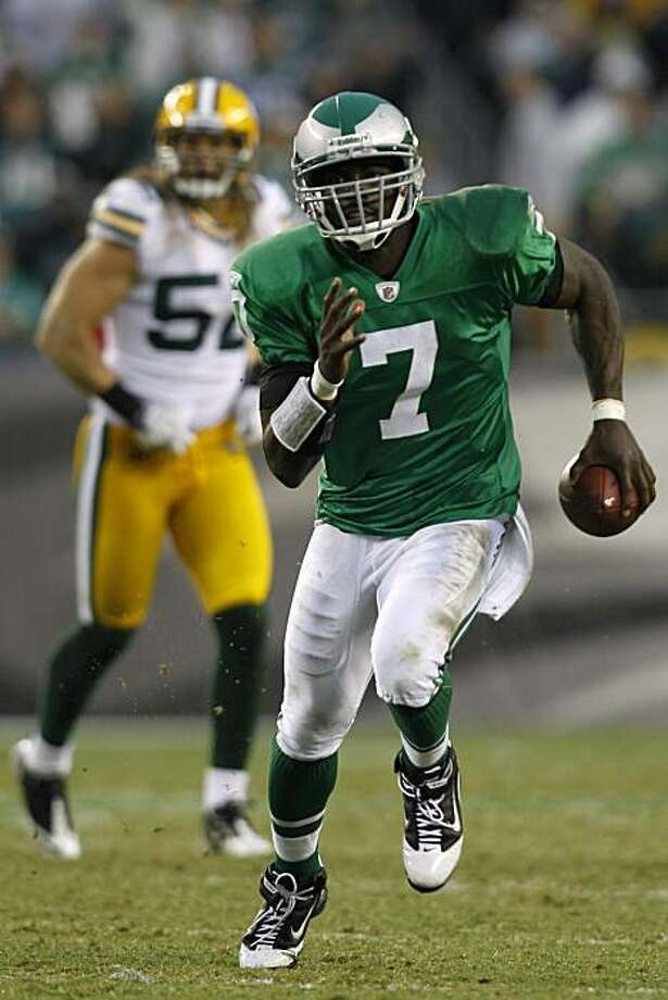Philadelphia Eagles quarterback Michael Vick, right, scrambles downfield in the second half of an NFL football game against the against the Green Bay Packers, Sunday, Sept. 12, 2010, in Philadelphia. Photo: Mel Evans, AP