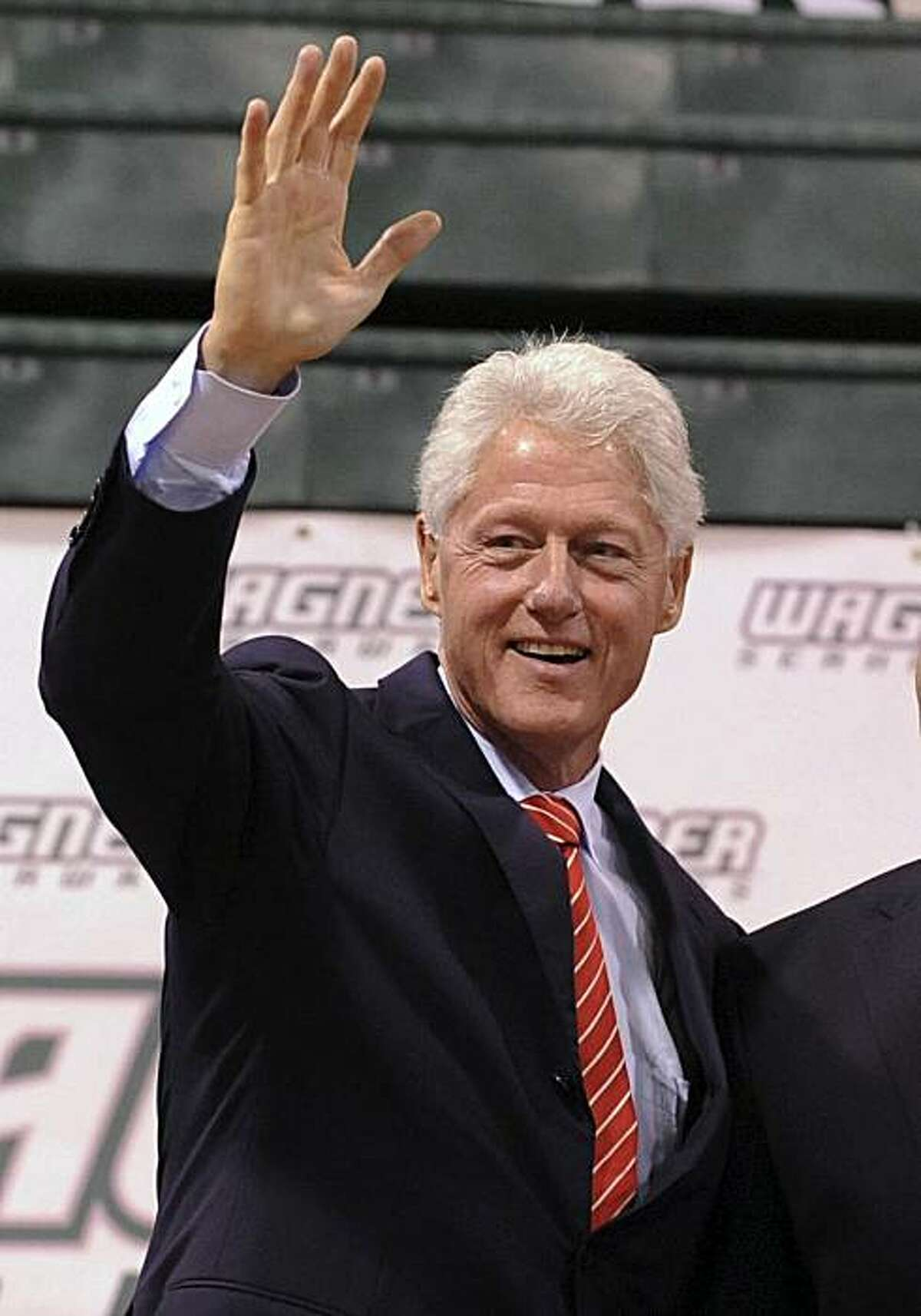 FILE - In this Sept. 8, 2010 file photo, former President Bill Clinton, left, appears at a rally in support of first-term Democratic Rep. Mike McMahon, in the Staten Island borough of New York. Comedy Central says former President Bill Clinton will visit