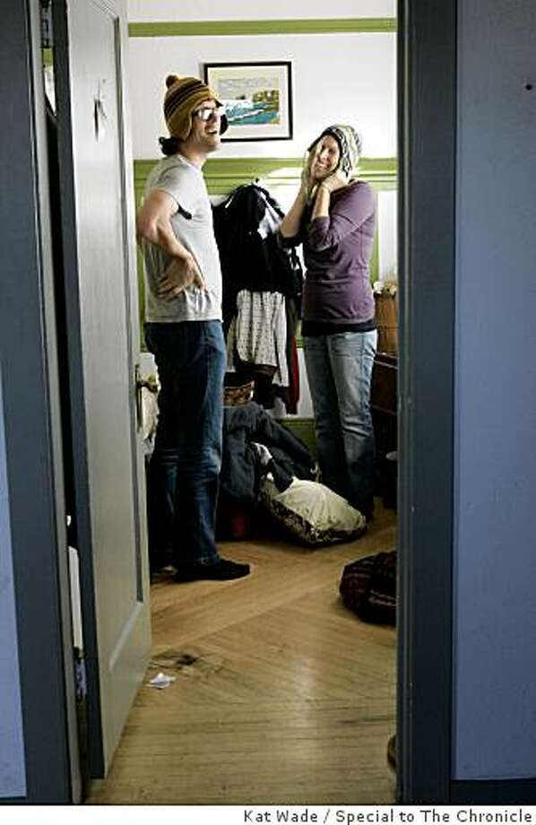 Newlyweds, Jason Pontius and Kate Schatz pack for a trip to Washington DC in the close quarters of their bedroom in Oakland, Calif. home on Saturday, January 17, 2009.  Schatz and Pontius knew each other five months before they moved in together for 3 and 1/2 years and were married in September on or about the conception of their baby.  Kate is four and 1/2 months pregnant.Photo by Kat Wade / Special to the Chronicle Photo: Kat Wade, Special To The Chronicle