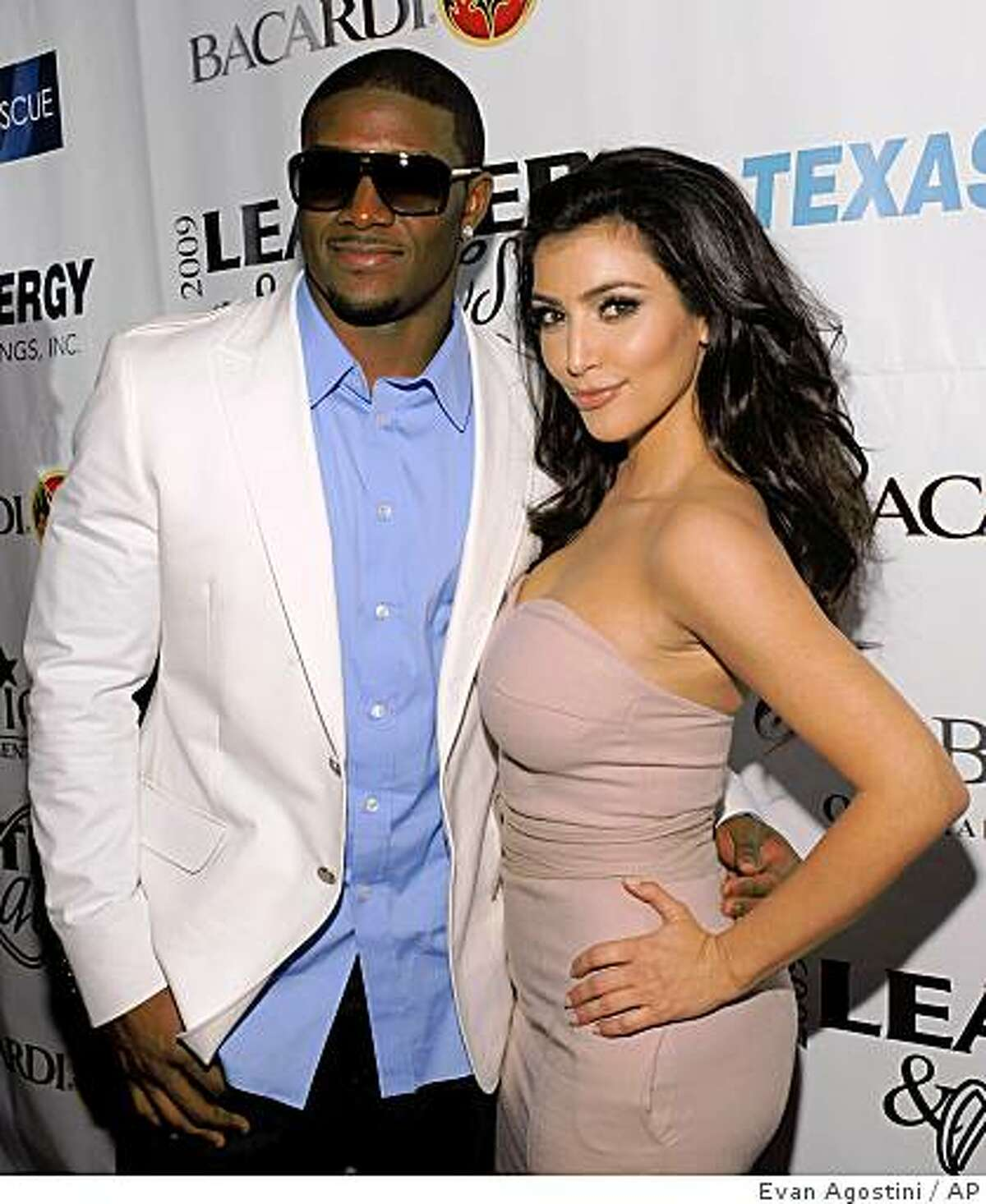 NFL player Reggie Bush and party co-host Kim Kardashian arrive at the 6th Annual Leather and Laces Super Bowl Celebration at Jackson?s, Friday, Jan. 30, 2009 in Tampa, Fla. (AP Photo/Evan Agostini)