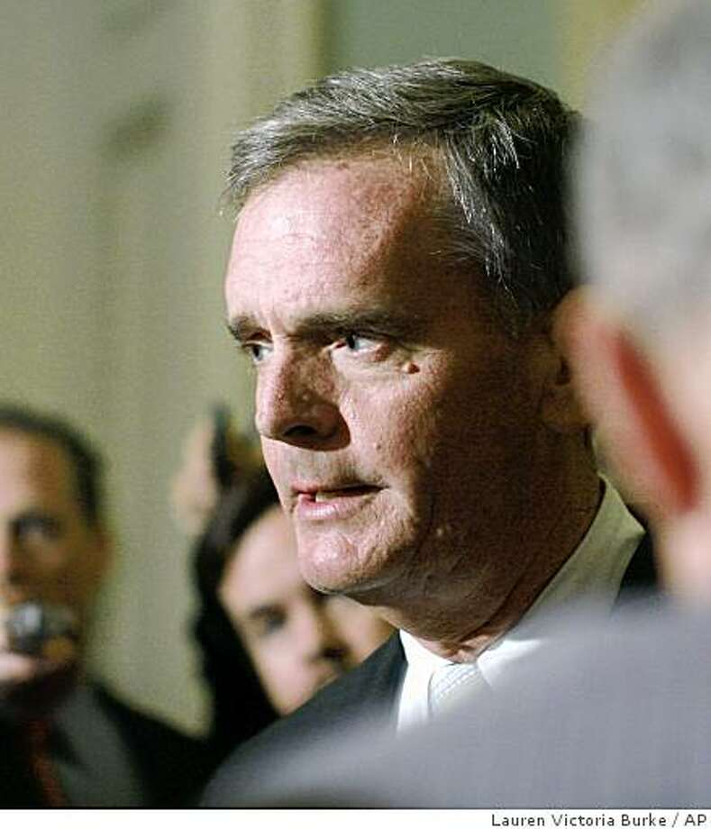 ** FILE ** In this Sept. 27, 2008 file photo, Sen. Judd Gregg, R-N.H. speaks to reporters on Capitol Hill in Washington. Gregg said Friday that he's being considered by President Barack Obama for a Cabinet appointment as head of the Commerce Department. (AP Photo/Lauren Victoria Burke, File) Photo: Lauren Victoria Burke, AP