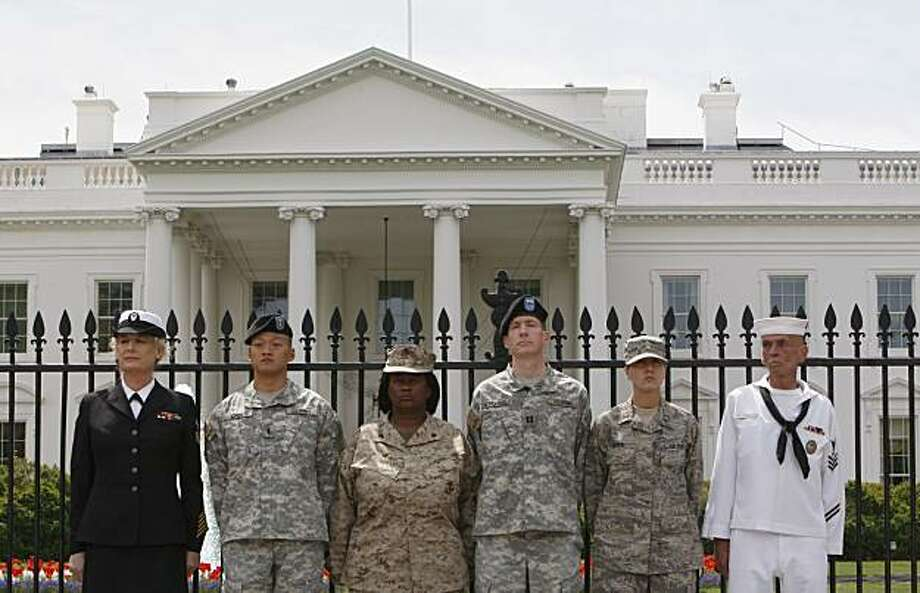 "In this Tuesday, April 16, 2010 picture, from left, Petty Officer Autumn Sandeen,  Lt. Dan Choi, Cpl. Evelyn Thomas, Capt. Jim Pietrangelo II, Cadet Mara Boyd and Petty Officer Larry Whitt, stand together after they handcuffed themselves to the fence outside the White House in Washington during a protest for gay rights. Elated by a major court victory, gay-rights activists are stepping up pressure on Congress to repeal the military's ""don't ask, don't tell"" policy before the 2010 election _ and thus avoidpotentially lengthy appeals over whether the ban on openly gay service members is unconstitutional. Photo: Pablo Martinez Monsivais, AP"