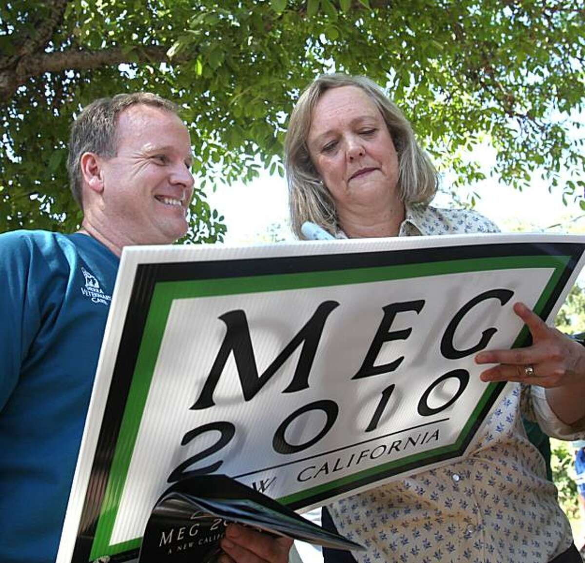 In this photo taken Saturday, Sept. 4, 2010,. Republican gubernatorial candidate Meg Whitman signs a campaign sign for Jeff Wittman at campaign stop in Columbia, Calif. Whitman, has repeatedly accused her opponent, Democrat Jerry Brown of allowing irresponsible growth in spending during his previous tenure at governor. A database analysis of Brown's eight years in office, by the Associated Press, found Whitman's characterizations to be misleading.