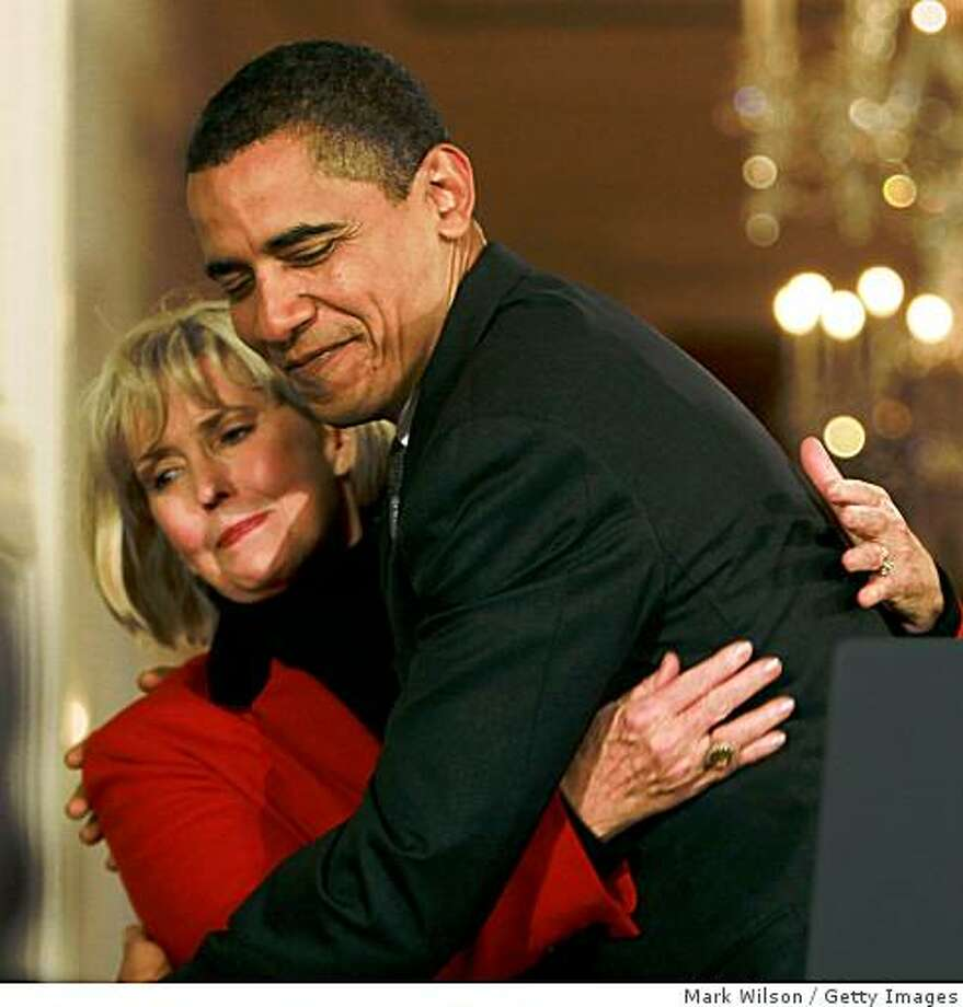 "WASHINGTON - JANUARY 29: U.S. President Barack Obama hugs Lilly Ledbetter before signing the ""Lilly Ledbetter Fair Pay Act duringn an event in the East Room of the White House January 29, 2009 in Washington, DC. The The Lilly Ledbetter Fair Pay Act was recently passed by congress granting equal pay to all women.  (Photo by Mark Wilson/Getty Images) Photo: Mark Wilson, Getty Images"