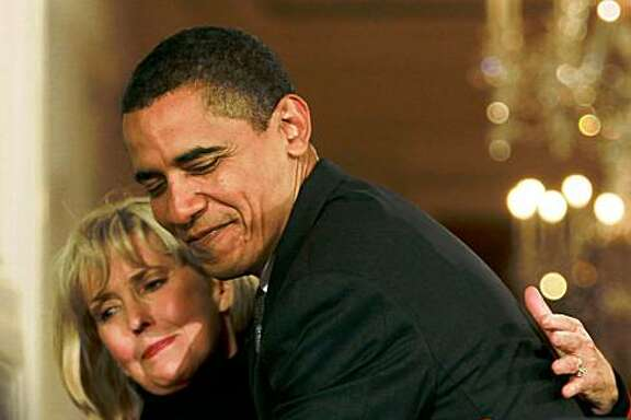"""WASHINGTON - JANUARY 29: U.S. President Barack Obama hugs Lilly Ledbetter before signing the """"Lilly Ledbetter Fair Pay Act duringn an event in the East Room of the White House January 29, 2009 in Washington, DC. The The Lilly Ledbetter Fair Pay Act was recently passed by congress granting equal pay to all women.  (Photo by Mark Wilson/Getty Images)"""