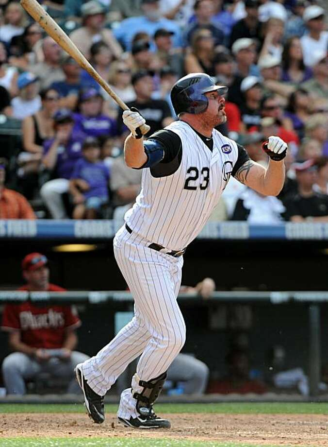 Colorado Rockies' Jason Giambi watches the flight of a game winning walk off two-run home run against the Arizona Diamondbacks during the ninth inning of a  baseball game in Denver, Sunday, Sept. 12, 2010. The Rockies beat the Diamondbacks 4-2. Photo: Jack Dempsey, AP