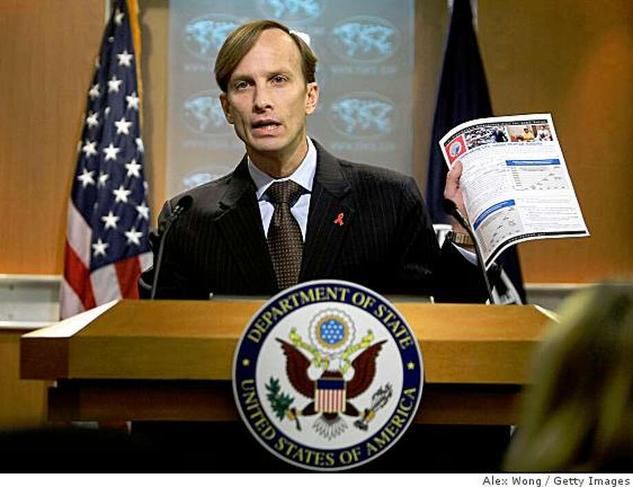 "WASHINGTON - JANUARY 12:  U.S. Global AIDS Coordinator Mark Dybul holds up a fact sheet on AIDS during a news conference at the Department of State January 12, 2009 in Washington, DC. Dybul briefed the media at the news conference of the release of ""The President's Emergency Plan for AIDS Relief 2009.""  (Photo by Alex Wong/Getty Images) Photo: Alex Wong, Getty Images"