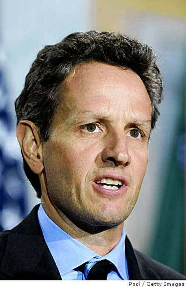 WASHINTON - JANUARY 26:  Timothy Geithner speaks after being sworn-in as U.S. treasury secretary at the Treasury Department January 26, 2009 in Washington, DC. Geithner was confirmed earlier in the evening in the Senate by 60 to 34 vote despite revelations that he had been delinquent in paying about $34,000 in taxes.  (Photo by Kevin Dietsch-Pool/Getty Images) Photo: Pool, Getty Images