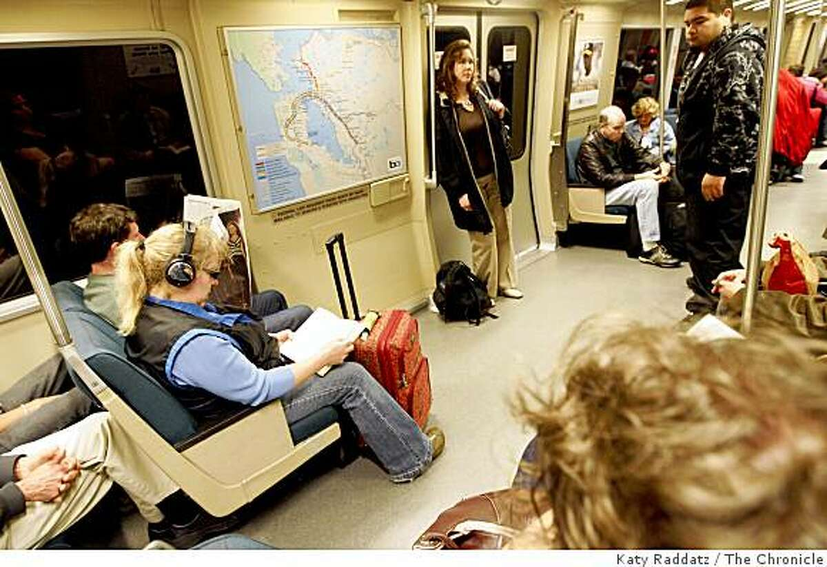 The open space formerly occupied by handicapped seats is a good place to stash one's luggage, as BART trains are being reconfigured to pack in more commuters by removing some seats and adding hanging hold straps in San Francisco, Calif.Katy Raddatz / The San Francisco Chronicle