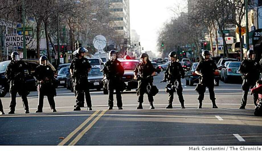 Police offficers patrol 14th Street where protesters took to the streets after former BART Officer Johannes Mehserle was granted bail at Alameda County Courthouse in Oakland, Calif., on Friday, Jan. 29, 2009. Photo: Mark Costantini, The Chronicle