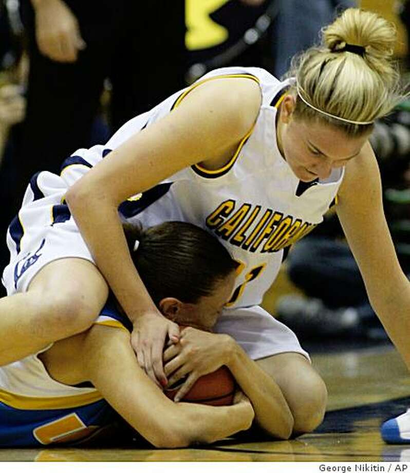 California's Kelsey Adrian, above, struggles for the ball with UCLA's Erica Tukiainen during the first half of an NCAA college basketball game Thursday, Jan. 29, 2009, in Berkeley, Calif. Photo: George Nikitin, AP