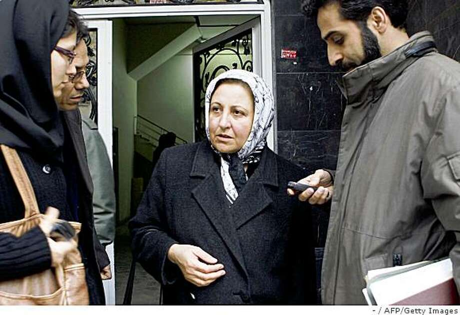 "Iranian Nobel peace laureate and women rights activist Shirin Ebadi (C) speaks to Journalists as she leaves her Human Rights Defenders Centre after Iranian police shut it down in Tehran on December 21, 2008. The closure marks a renewed crackdown on rights campaigners by the Islamic republic, which Ebadi's group accuses of ""systematically violating"" human rights in Iran. AFP PHOTO/STR (Photo credit should read -/AFP/Getty Images) Photo: -, AFP/Getty Images"
