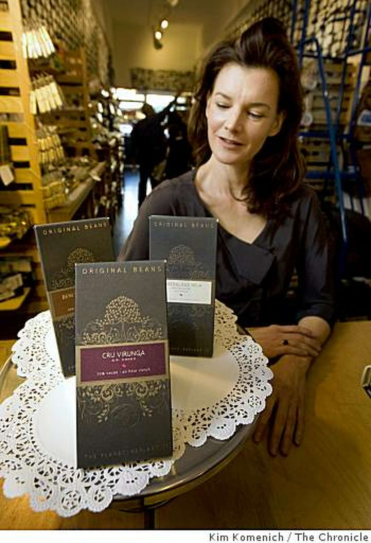 """Lesal Ruskey, co-founder of Original Beans, stands next to a display of her company's product at the """"Chocolate Covered"""" store at 4069 24th St. in San Francisco, Calif., on Thursday, Jan. 29, 2009. Original Beans produces chocolate from known fair trade sources."""