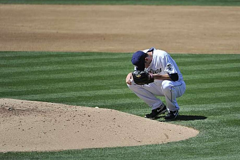 San Diego Padres pitcher Jon Garland bends down next to the mound after giving up a double to the Colorado Rockies' Troy Tulowitzki during the third inning of a baseball game Saturday, Sept. 4, 2010 in San Diego.  The Rockies won 6-2. Photo: Denis Poroy, AP