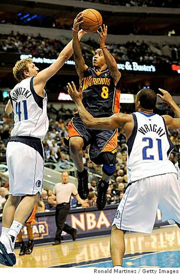 DALLAS - JANUARY 28: Guard Monta Ellis #8 of the Golden State Warriors takes a shot against Dirk Nowitzki #41 of the Dallas Mavericks on January 28, 2009 at American Airlines Center in Dallas, Texas. NOTE TO USER: User expressly acknowledges and agrees that, by downloading and/or using this Photograph, user is consenting to the terms and conditions of the Getty Images License Agreement. (Photo by Ronald Martinez/Getty Images) Photo: Ronald Martinez, Getty Images