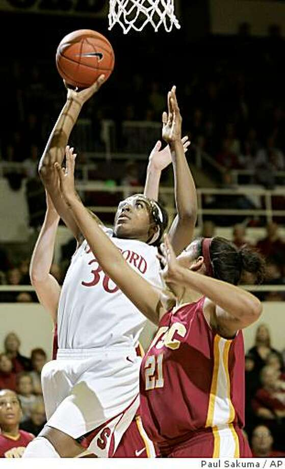 Stanford forward Nnemkadi Ogwumike (30) drives to the basket in front of Southern California guard Aarika Hughes (21) in the first half of an NCAA college women's basketball game in Stanford, Calif., Thursday, Jan. 29, 2009. Photo: Paul Sakuma, AP