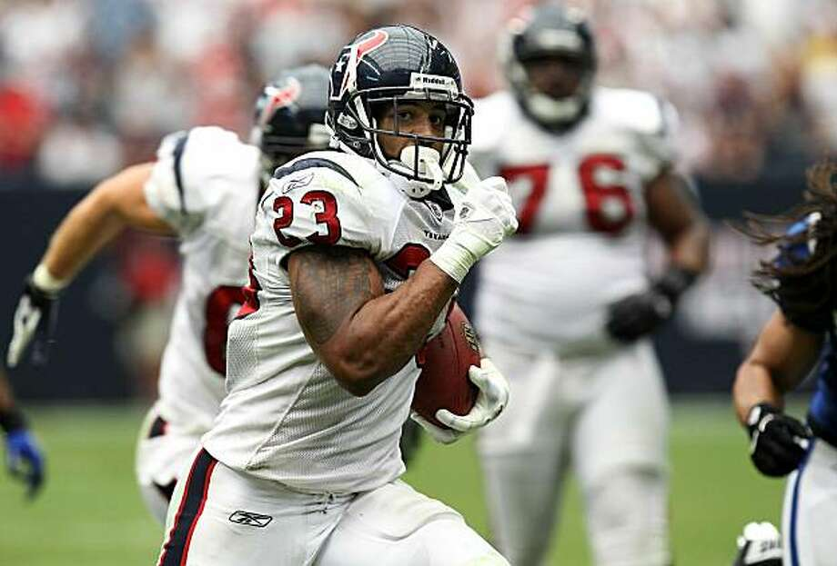 HOUSTON - SEPTEMBER 12:  Running back Arian Foster #23 of the Houston Texans runs for a touchdown in the NFL season opener against the Indianapolis Colts at Reliant Stadium on September 12, 2010 in Houston, Texas. Photo: Ronald Martinez, Getty Images