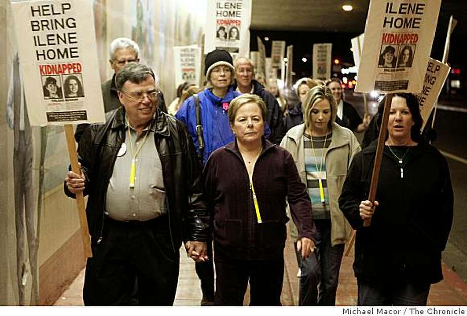 Michael, (left) and Maddi, (center) Misheloff, are joined by dozens as the community of Dublin holds a candlelight vigil and walk on Thursday Jan. 29, 2008, to mark the 20th anniversary of their 13-year-old Ilene Misheloff  who disappeared from the streets of Dublin, Calif. Liz cuevas, (right) has joined the Misheloffs for the past 19 walks through the city. Photo: Michael Macor, The Chronicle