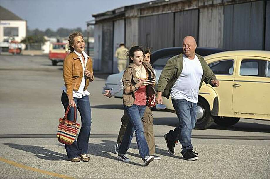 """NO ORDINARY FAMILY - The Powells are about to go from ordinary to extraordinary. After 16 years of marriage, Jim (Michael Chiklis, """"The Shield,"""" """"Fantastic Four"""") feels disconnected from his workaholic wife, Stephanie (Julie Benz, """"Dexter""""), and two teenage children, Daphne (Kay Panabaker, """"Summerland"""") and JJ (Jimmy Bennett, """"Star Trek""""). To encourage family bonding time, Jim decides the family will join Stephanie on her business trip to South America. When their plane crashes into the Amazon River, they barely enjoy a moment to celebrate their survival before returning to the grind of everyday life. But they will soon realize that their lives have been forever changed. Each member of the family starts to show signs of new, unique and distinct super powers. Will their newfound abilities finally bring them together or push them further apart? Photo: Eric McCandless, ABC"""