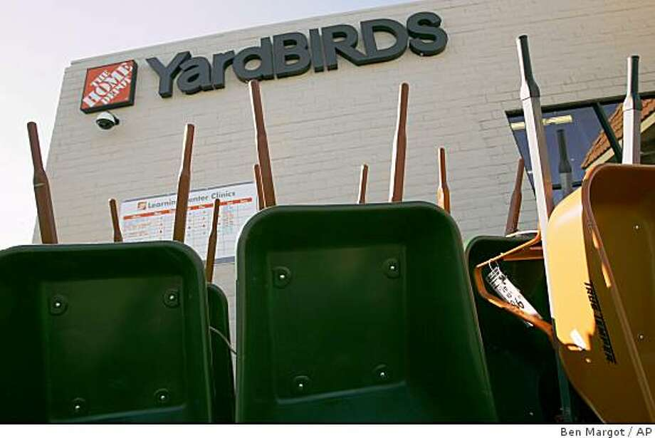 Wheelbarrows are seen lining the Home Depot/YardBIRDS storefront Monday, Jan 26, 2009, in San Pablo, Calif. Home Depot Inc. plans to eliminate 7,000 jobs while shutting down its smaller home improvement brands as the recession continues to batter the nation's housing market. Most of the cuts affect workers at Expo Design Centers, YardBIRDS, Design Centers and HD Bath, a bath remodeling business. (AP Photo/Ben Margot) Photo: Ben Margot, AP