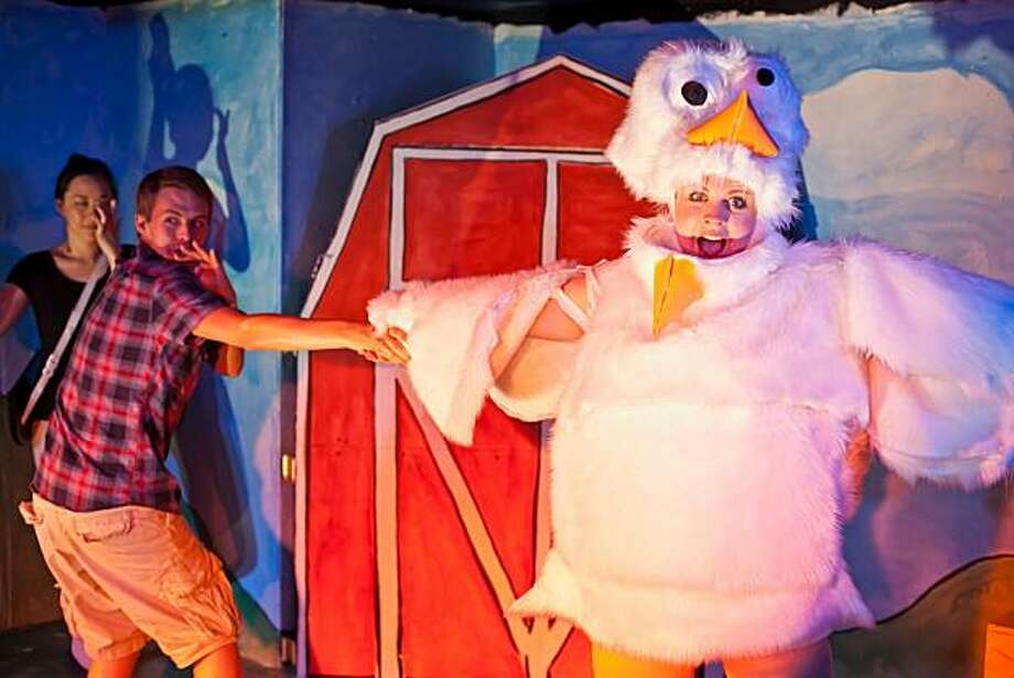 "Emory (Charlie Cromer, left front) dances with his chicken friend Linda (Sarah Coykendall) as the narrator (Cindy Im, left rear) looks on in ""MilkMilkLemonade"" at Impact Theatre Photo: Cheshire Isaacs"