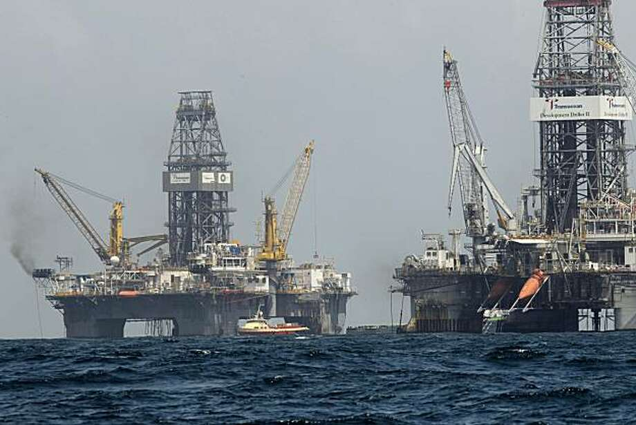 The Development Driller II, right, and Development Driller III, which are drilling the relief wells, are seen at the Deepwater Horizon oil spill site in the Gulf of Mexico, off the Louisiana coast, Thursday, July 22, 2010. Photo: Gerald Herbert, AP