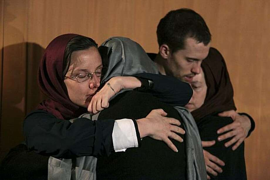 FILE - In this May 21, 2010 file photo, Sarah Shourd, left, hugs her mother Nora Shourd, as Shane Bauer, second right, hugs his mother Cindy Hickey, during their meeting at the Esteghlal hotel in Tehran. Iran announced Thursday that one of the three Americans jailed for more than a year will be released Saturday to mark the end of Islamic holy month of Ramadan. Photo: Stringer, AP