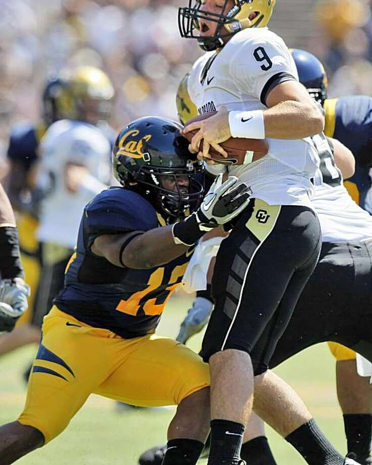 Cal linebacker, Jarred Price wraps up Colorado University's Tyler Hansen during the bears game against the Buffaloes on Saturday, September 11, 2010. Photo: Lance Iversen, The Chronicle