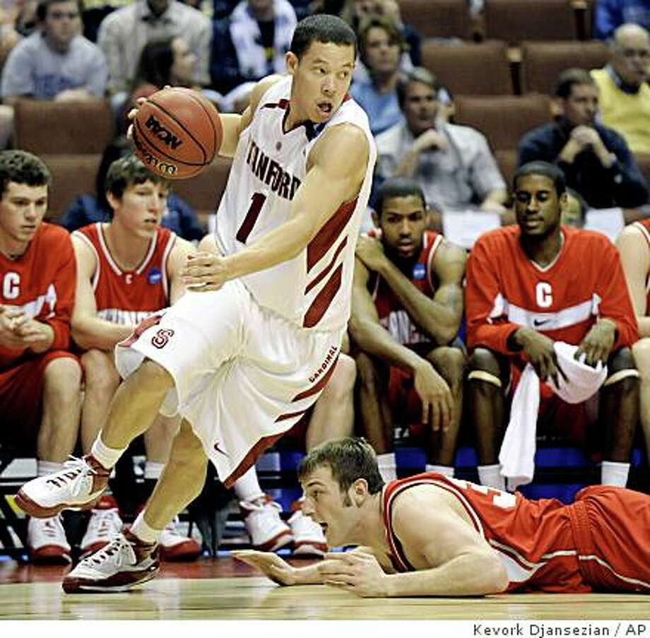 Stanford's Mitch Johnson moves away with the ball as Cornell's Alex Tyler slides on the floor during the second half of a first-round game at the NCAA men's basketball tournament South Regional on Thursday, March 20, 2008, in Anaheim, Calif. (AP Photo/Kevork Djansezian) Photo: Kevork Djansezian, AP
