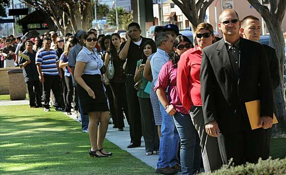 Unemployed Americans line up to enter a job fair on the first day of the Labor Day long weekend in the City of El Monte outside of Los Angeles on September 4, 2010. US unemployment jumped to 9.6 percent in August, the Labor Department said, showing the recovering economy is still struggling to create jobs. In a keenly awaited unemployment report, the department said the economy lost 54,000 jobs last month, a better figure than the 120,000 loss expected by economists. The figures are seen as a crucial litmus test for the sputtering economic recovery and President Barack Obama's policies. Photo: Mark Ralston, AFP/Getty Images