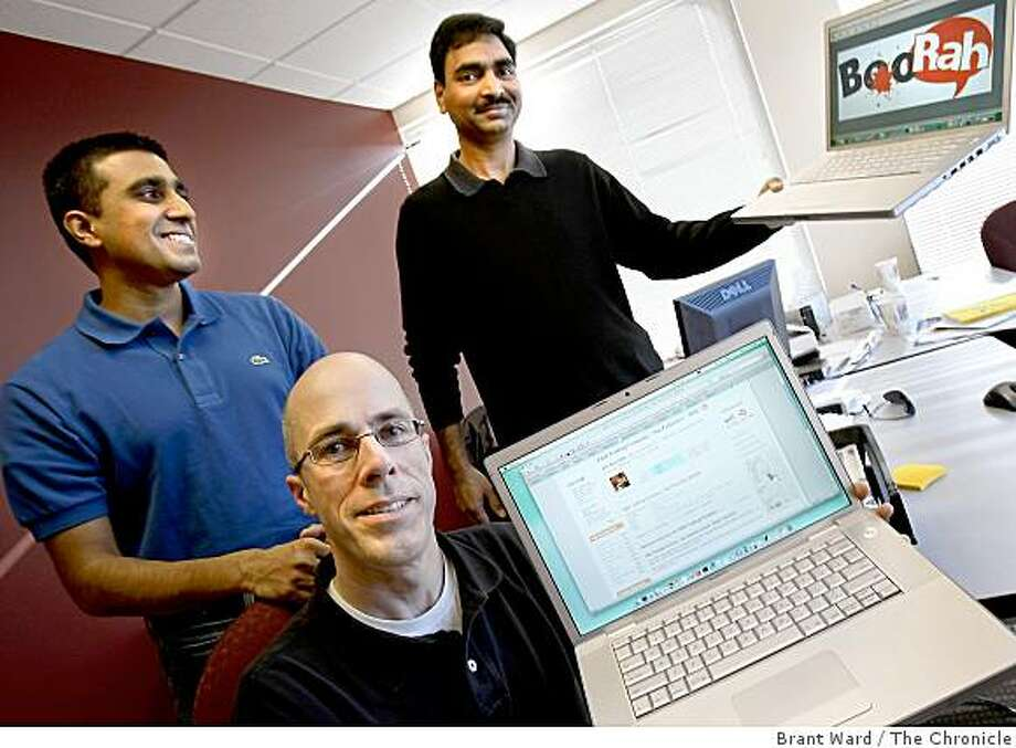 A new Web site called boorah.com rates Bay Area restaurants using diners comments and restaurant reviews. CEO Eric Moyer (center) shows off a review on his website while Shrisha Radhakrishna (left) and Nagaraju Bandaru (right) with company logo in their Mountain View offices Monday January 26, 2009. Photo: Brant Ward, The Chronicle