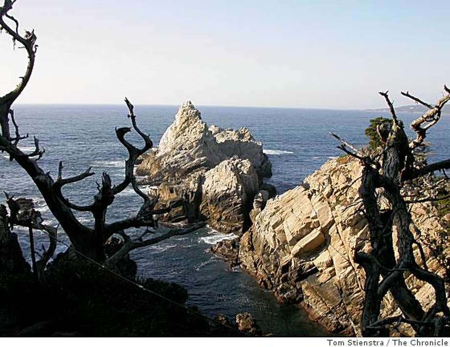 The trails at Point Lobos State Reserve on the Monterey coast lead to spectacular cliff-top views.  In this picture is Pinnacle Point, photographed from the Cypress Grove Trail. Photo: Tom Stienstra, The Chronicle