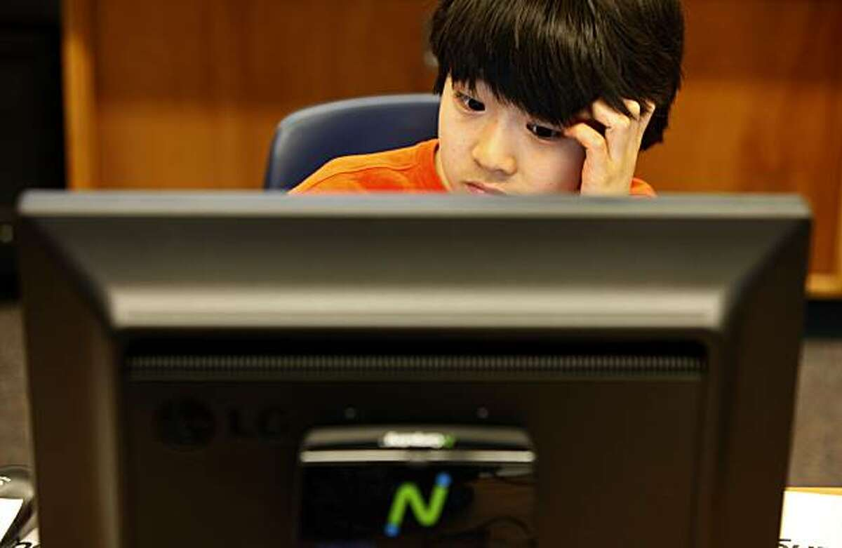 Fourth grader, Shun Ishida works on one of the new computers. Students at Rheem Elementary school in Moraga Ca are working with thin computing machines from Redwood City-based NComputing. One of the benefits is six to ten students can share one PC as they work separately.