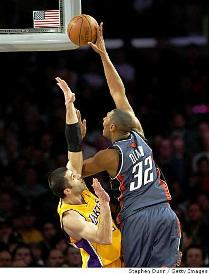 LOS ANGELES - JANUARY 27:  Boris Diaw #32 of the Charlotte Bobcats shoots over Vladimir Radmanovic #10 of the Los Angeles Lakers on January 27, 2009 at Staples Center in Los Angeles, California.   NOTE TO USER: User expressly acknowledges and agrees that, by downloading and/or using this Photograph, user is consenting to the terms and conditions of the Getty Images License Agreement. (Photo by Stephen Dunn/Getty Images) Photo: Stephen Dunn, Getty Images