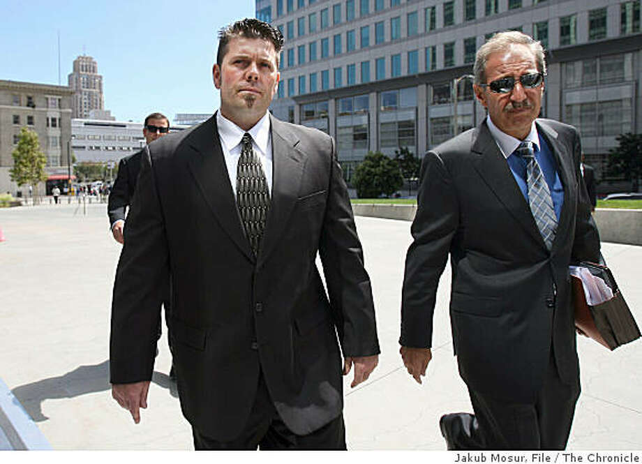 Greg Anderson walks with attorney Mark Geragos to the federal building in San Francisco. Anderson, who is Barry Bonds' trainer, was held in contempt of court and jailed for refusing to testify before a grand jury. Photo: Jakub Mosur, File, The Chronicle