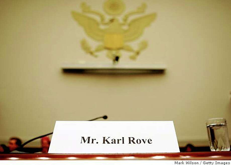 WASHINGTON - JULY 10:  A chair for Karl Rove sits empty behind his name card during a House Judiciary Committee hearing on Capitol Hill July 10, 2008 in Washington DC. Former White House Deputy Chief of Staff Karl Rove has been subpoenaed to testify but did not show up. (Photo by Mark Wilson/Getty Images) Photo: Mark Wilson, Getty Images